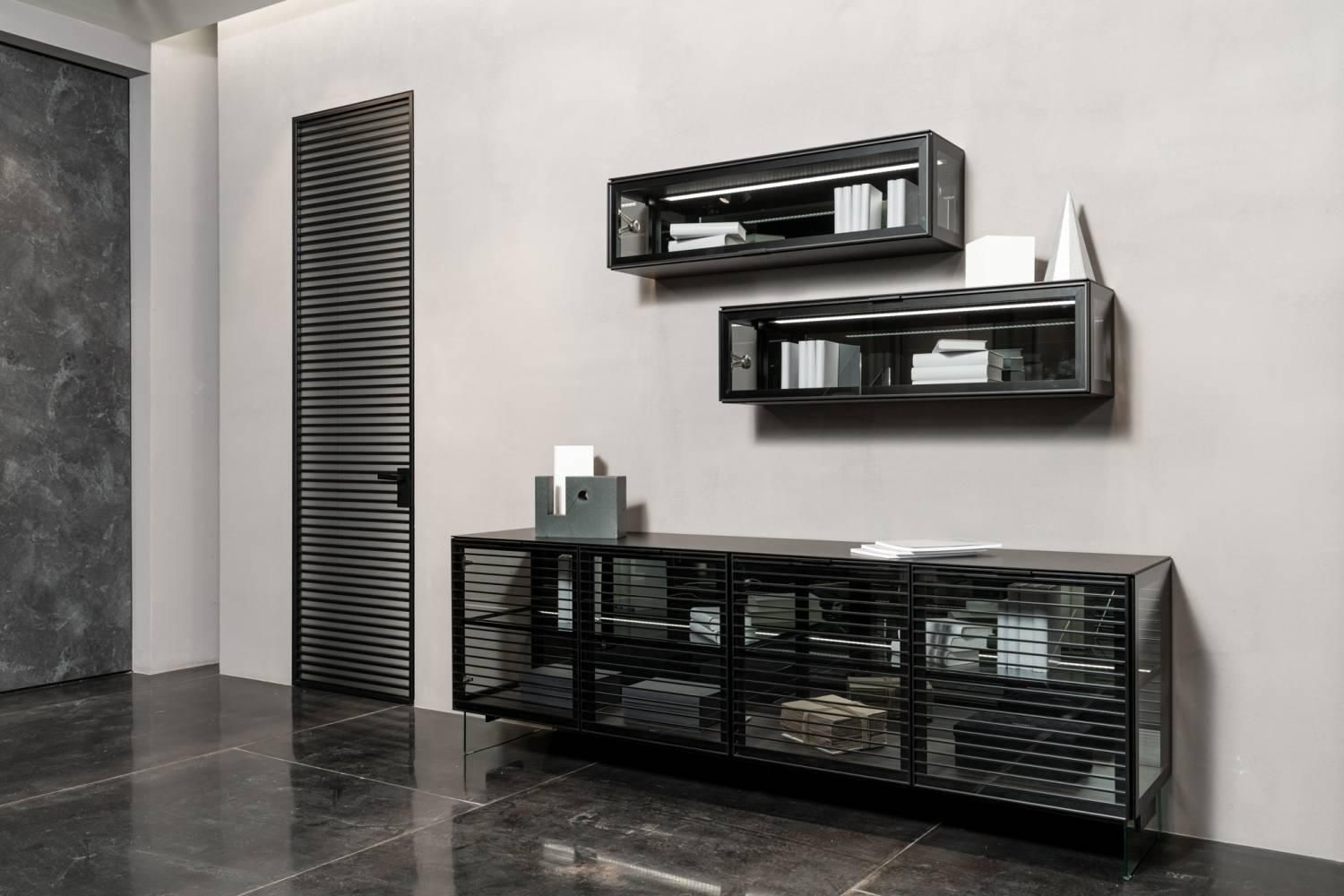 UBIK chest of drawers. The facade of the Largo LINEA layout of aluminium profile. Shelves, sidewalls Grey Transparent glass. Aluminum profile Black Matt Color. The back wall of the Mirror. The legs are made of glass.